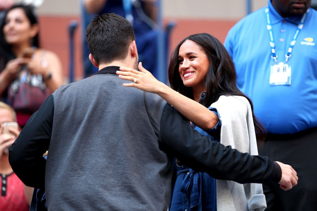 Alexis Ohanian embraces Meghan before the Women's Singles final match. | Source: Getty Images