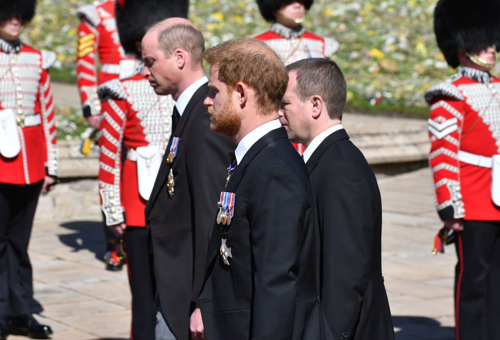 Prince William, Prince Harry, and Peter Phillips walk behind Prince Philip's coffin during the funeral at Windsor Castle on April 17, 2021 in Windsor, United Kingdom. | Photo: Getty Images
