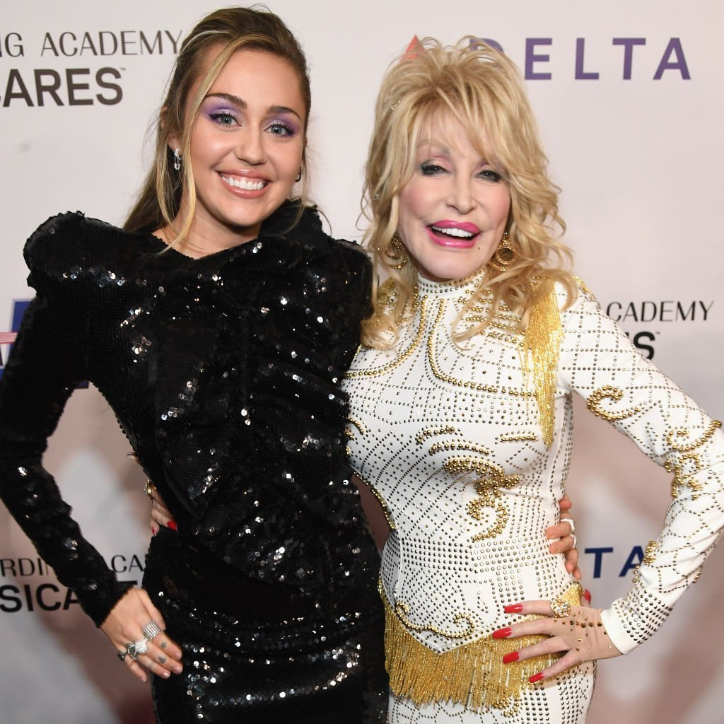 Miley Cyrus and Dolly Parton at the MusiCares Person of the Year on February 8, 2019   Photo: GettyImages