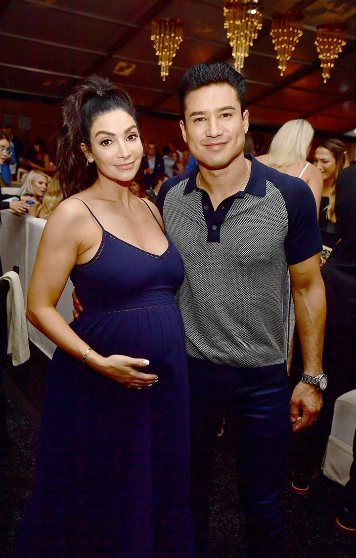 Mario Lopez and a pregnant Courtney. I Image: Getty Images.