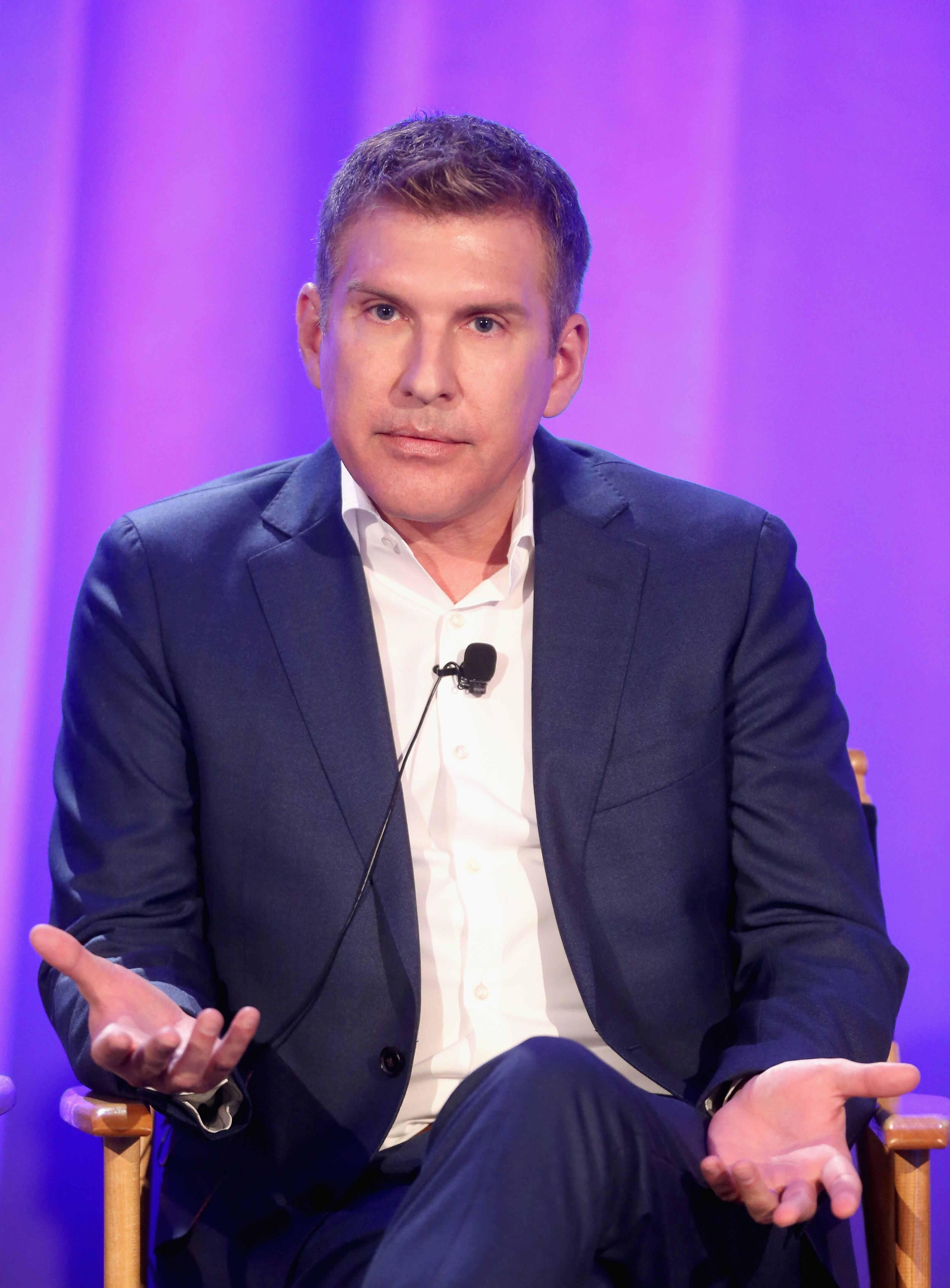 Todd Chrisley speaks before an audience. | Source: Getty Images