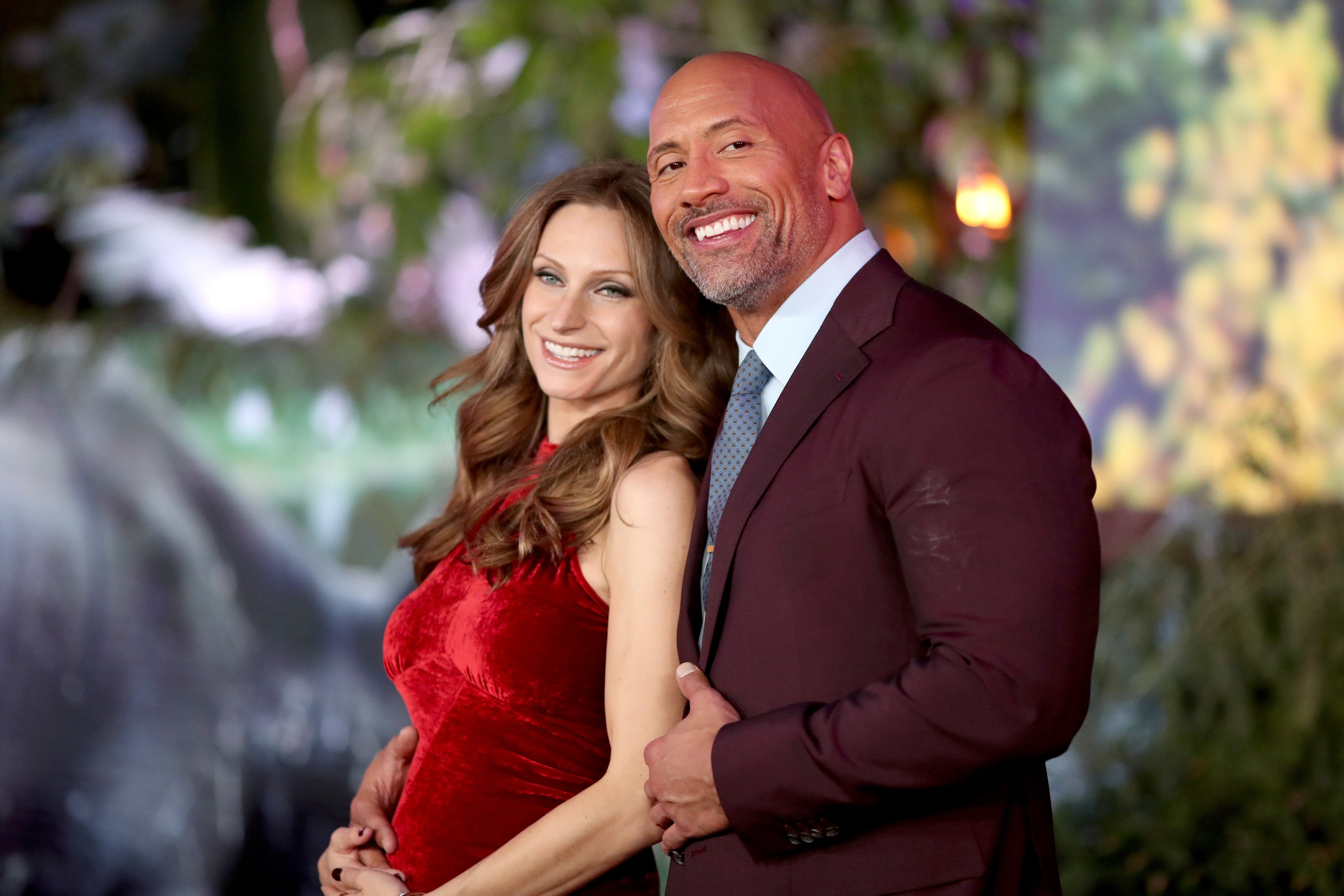 "Lauren Hashian and Dwayne Johnson attend the premiere of ""Jumanji: Welcome To The Jungle"""