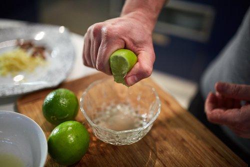A man squeezing a lemon.   Source: Shutterstock.
