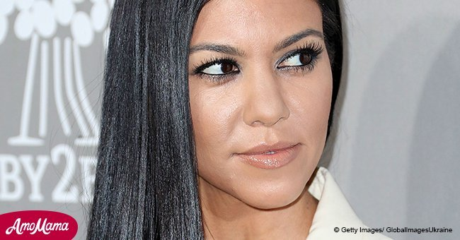 Kourtney Kardashian's much-younger boyfriend was reportedly spotted hugging a mystery woman