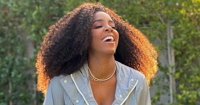 Kelly Rowland & Son Noah Flaunt Curly Hair in Matching Gray Outfits as She Sings to Him in a Video