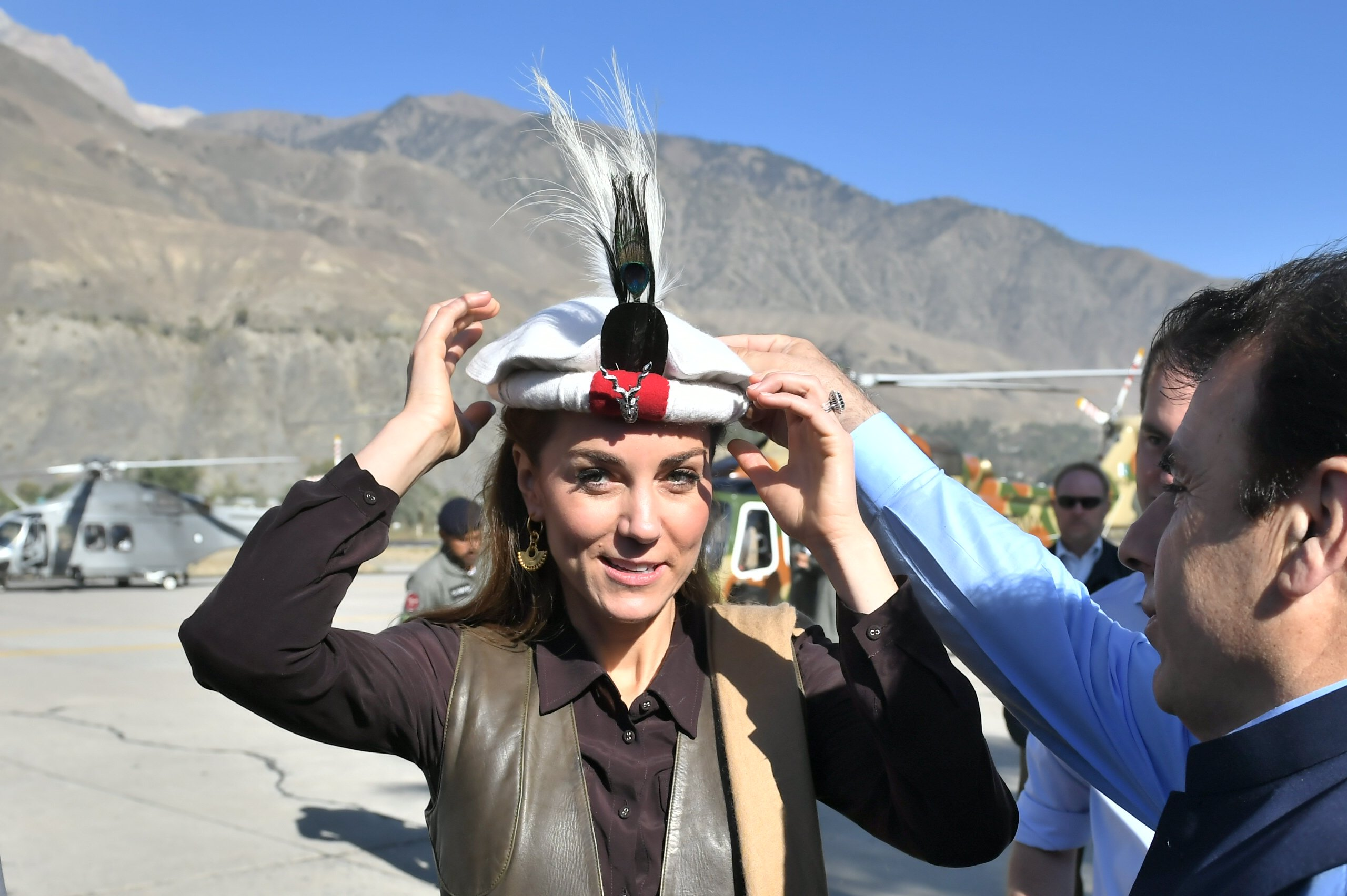 Prince William and Kate Middleton are welcomed as they arrive by helicopter on October 16, 2019, in Chitral, Pakistan. | Source: Getty Images.