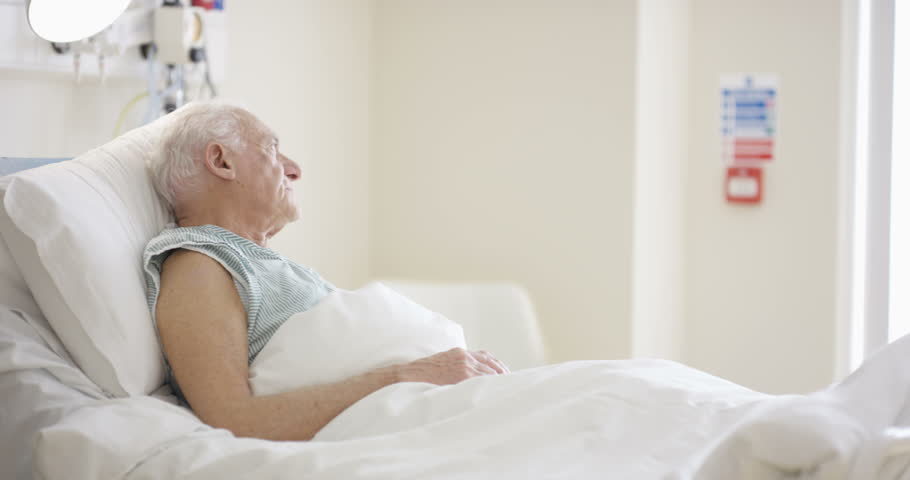 Photo of an elderly man on a sick bed | Source: Shutterstock