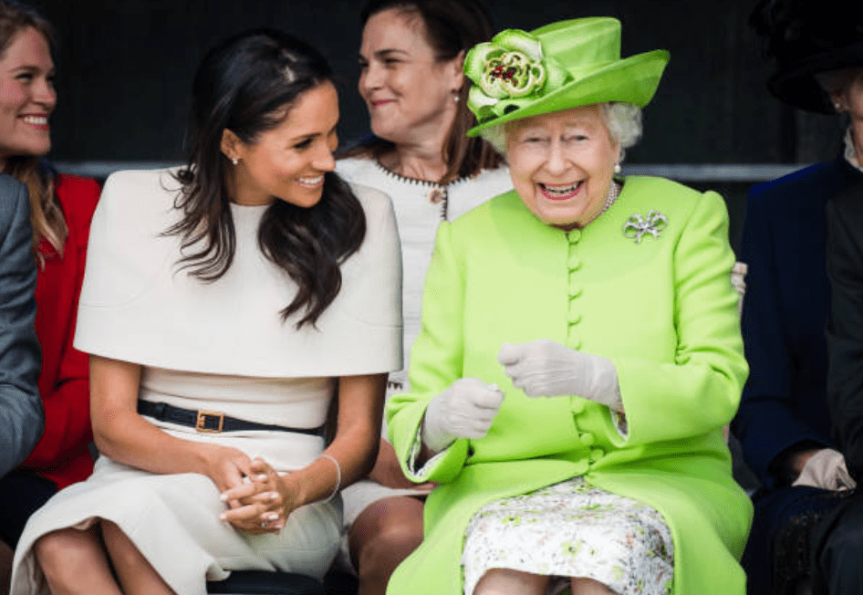 Meghan Markle shareda laugh with Queen Elizabeth during an event for the opening of the new Mersey Gateway Bridge, on June 14, 2018, in Widness, England | Source: Getty Images (Photo by Samir Hussein/Samir Hussein/WireImage)