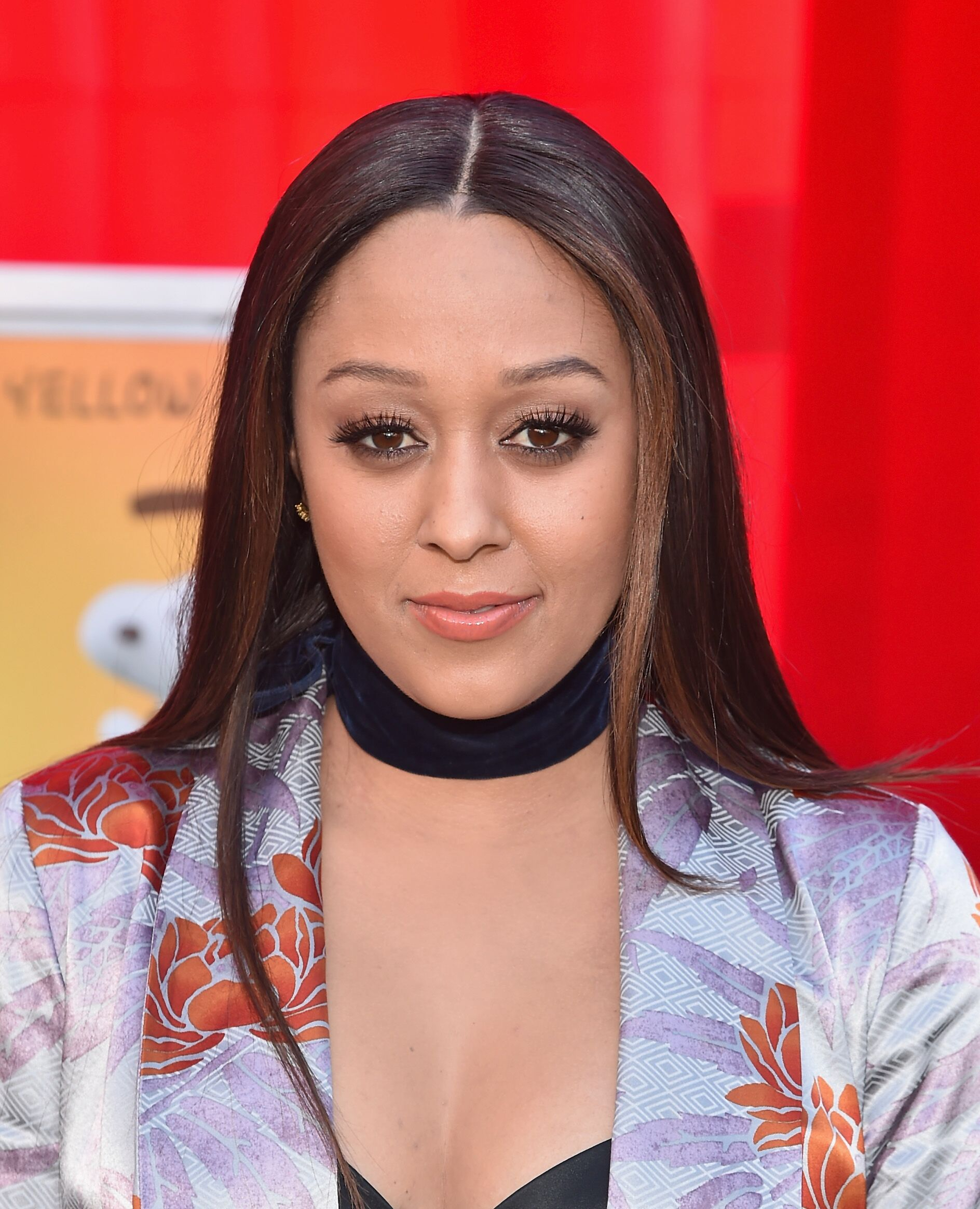 "Tia Mowry at the premiere of 20th Century Fox'd ""The Peanuts Movie""/ Source: Getty Images"