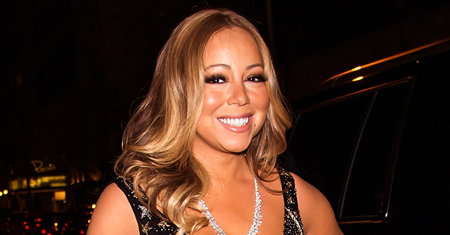 Singer Mariah Carey Defied Age Showing off Her Toned Body in a Black Swimsuit & Colorful Robe