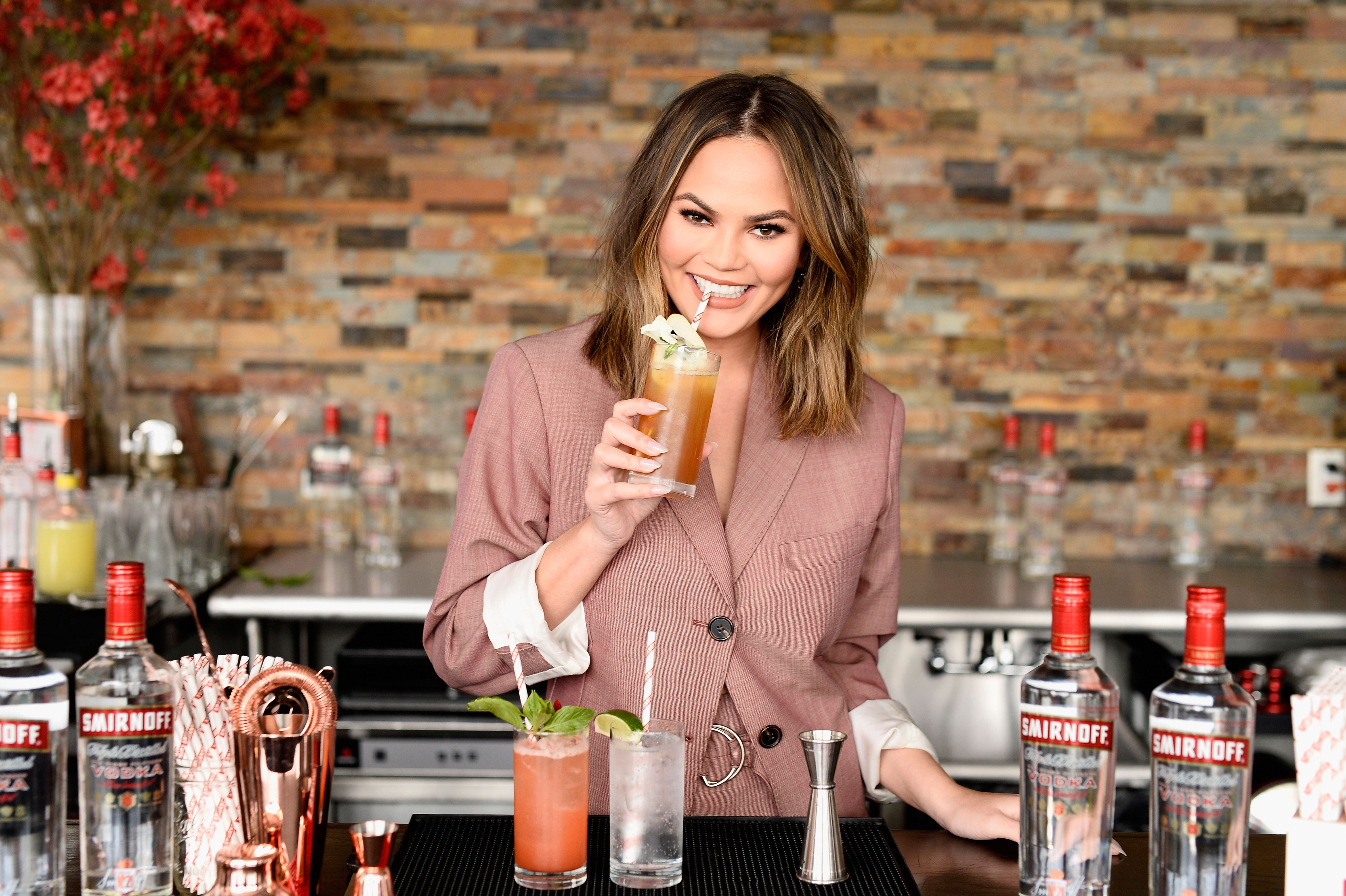 "Chrissy Teigen hosts a ""Cocktails with Chrissy"" Smirnoff event on April 27, 2017, in New York City. 