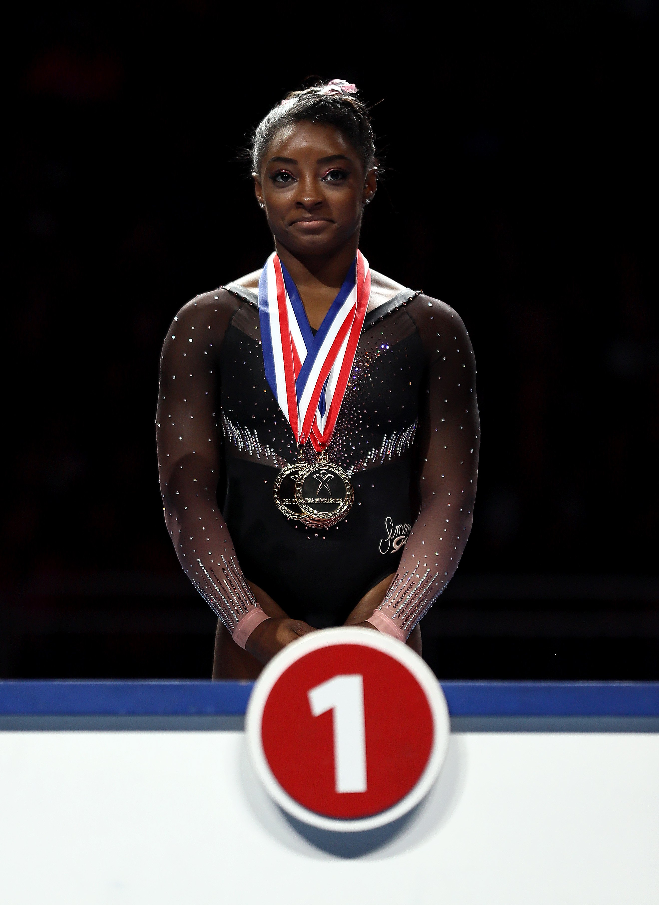 Simone Biles on the podium after accepting her gold medal during the Women's Senior competition at the 2019 US Gymnastics Championships on August 11, 2019. | Photo: Getty Images