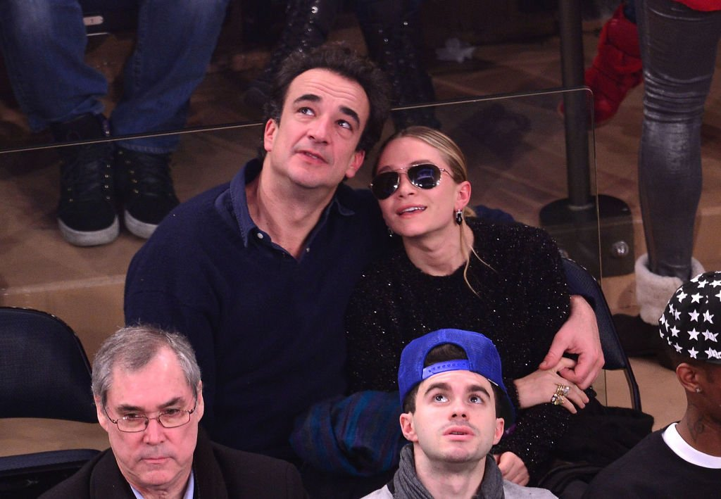 Mary-Kate Olsen and Olivier Sarkozy attend the New York Knicks vs Atlanta Hawks game in New York City on December 14, 2013 | Photo: Getty Images