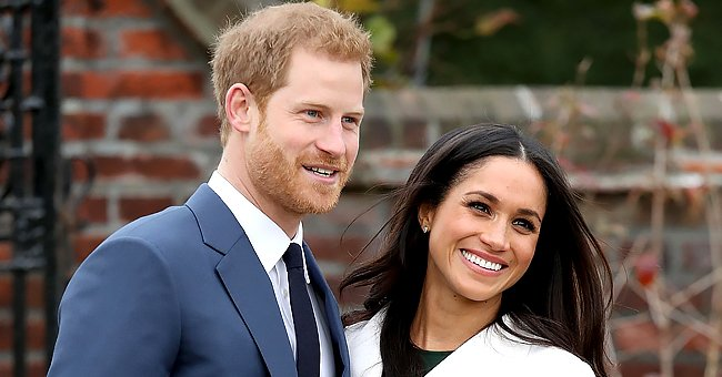 Prince Harry and Meghan Markle during an official photoshoot to announce their engagement at The Sunken Gardens at Kensington Palace on November 27, 2017 in London, England. | Photo: Getty Images.