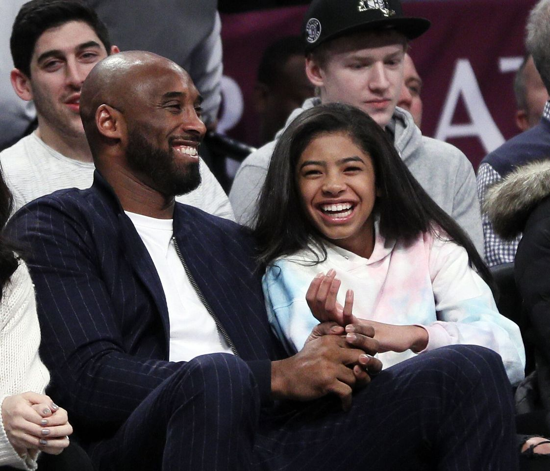 Kobe Bryant and his daughter Gigi, watch an NBA basketball game between the Brooklyn Nets and Atlanta Hawks. | Source: Getty Images