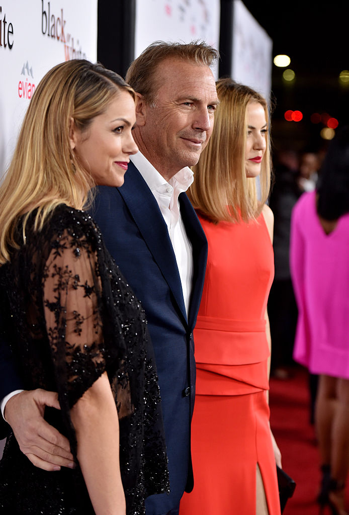 "Image Credits: Getty Images: Kevin Costner, Christine Baumgartner and daughter Lily Costner at the premiere of  ""Black Or White"""