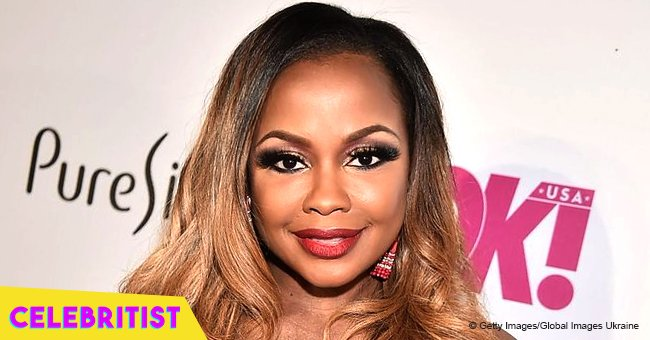Phaedra Parks stuns in one-piece swimsuit while playing with her sons in the pool