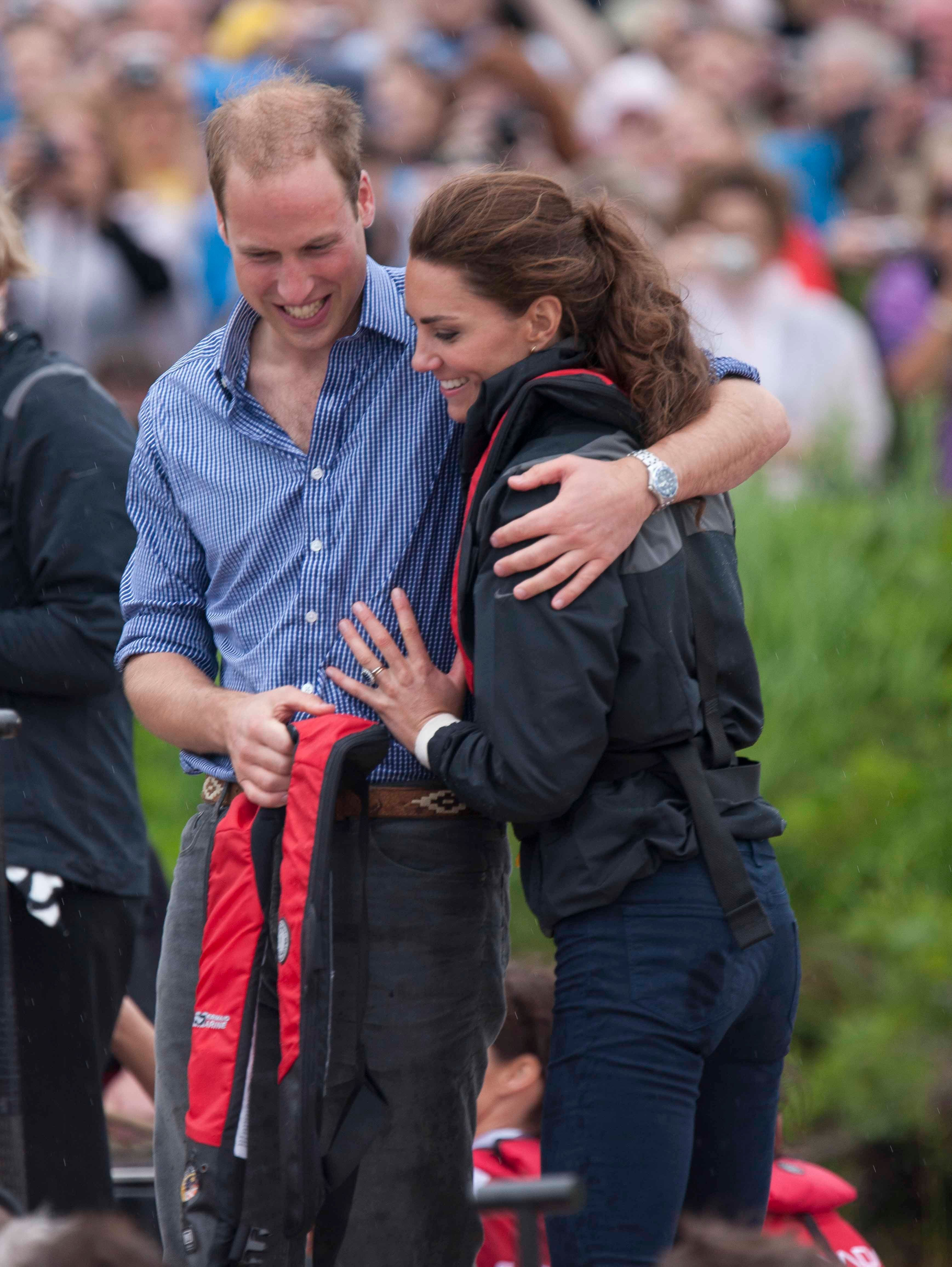 Prince William and Kate Middleton sharing a warm embrace | Photo: Getty Images