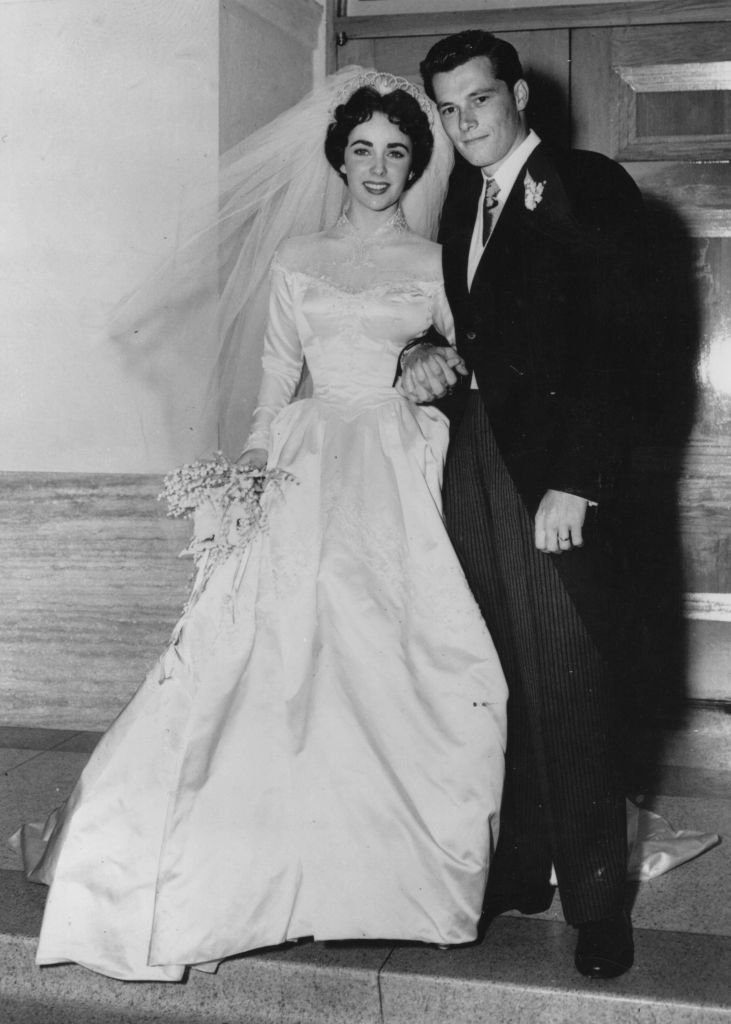 Elizabeth Taylor and hotelier Conrad Hilton after their wedding in Hollywood | Getty Images
