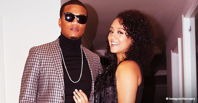 Tia Mowry Stuns in Fringed Black Dress and High Heels in Pic with Husband While 'out on the Town'