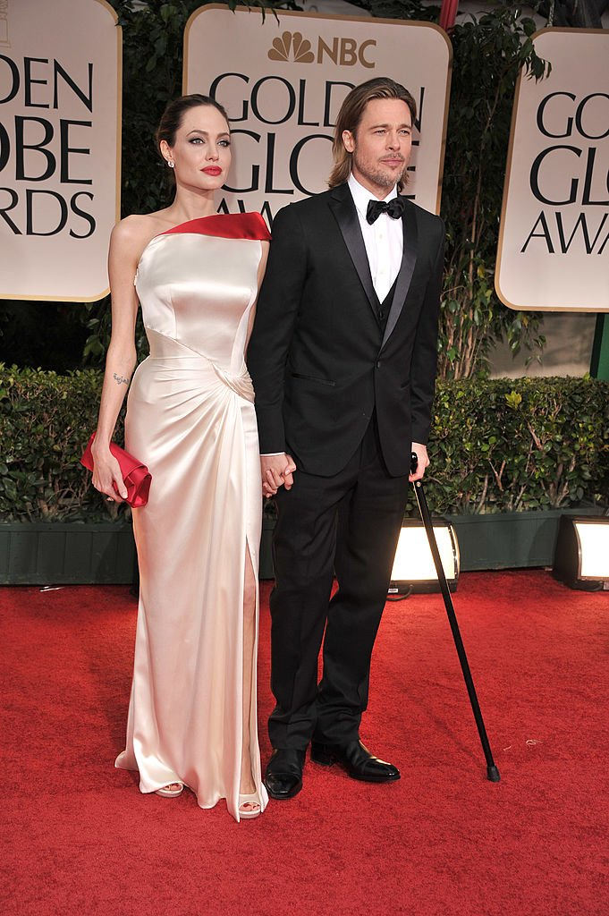 Angelina Jolie and Brad Pitt arrive at the 69th Annual Golden Globe Awards at The Beverly Hilton hotel on January 15, 2012 | Photo: Getty Images