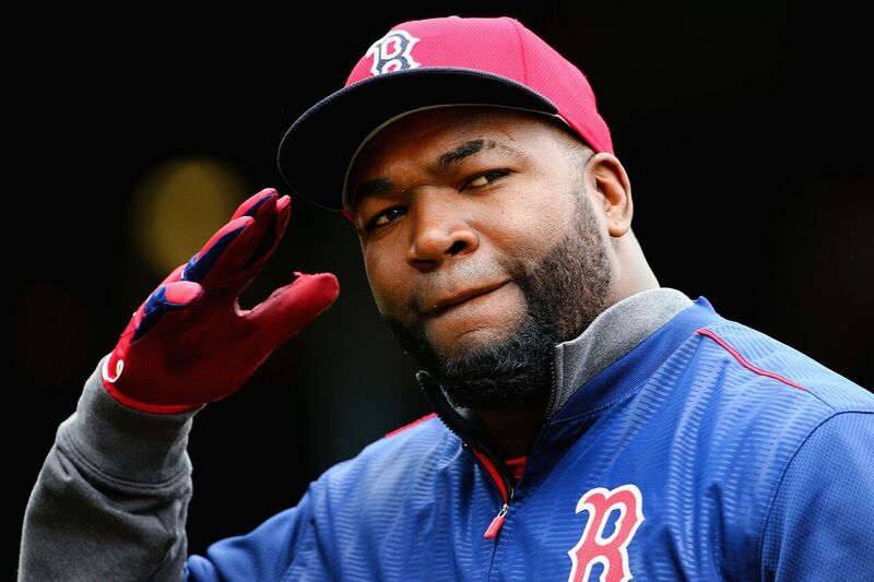 David Ortiz salutes the camera in full Red Sox gear | Source: Getty Images/GlobalImagesUkraine