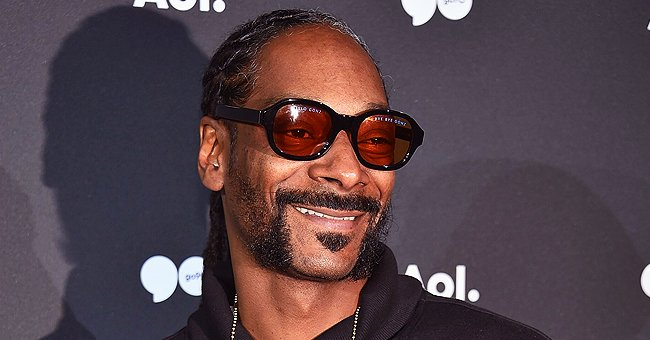 Snoop Dogg's 1-Year-Old Granddaughter Eleven Plays with Dad Corde Broadus near Plastic Ball Pool