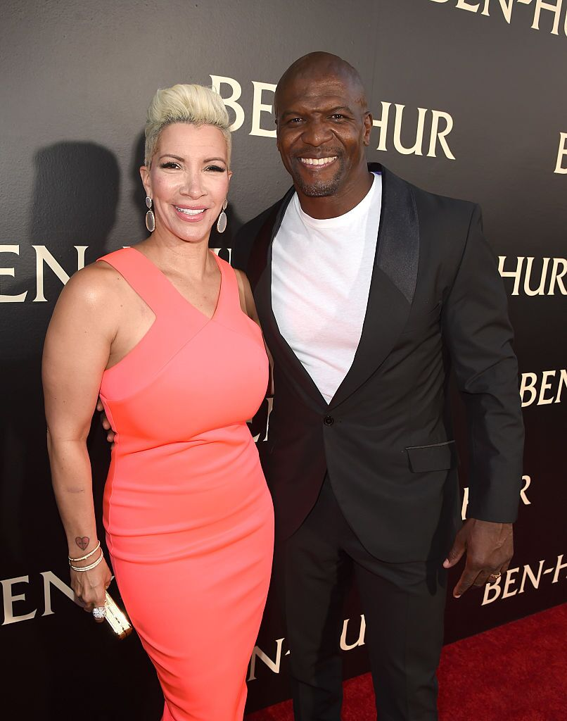 "Terry Crews (R) and his wife Rebecca King-Crews arrive at the premiere of Paramount Pictures' ""Ben-Hur"" at the Chinese Theatre. 
