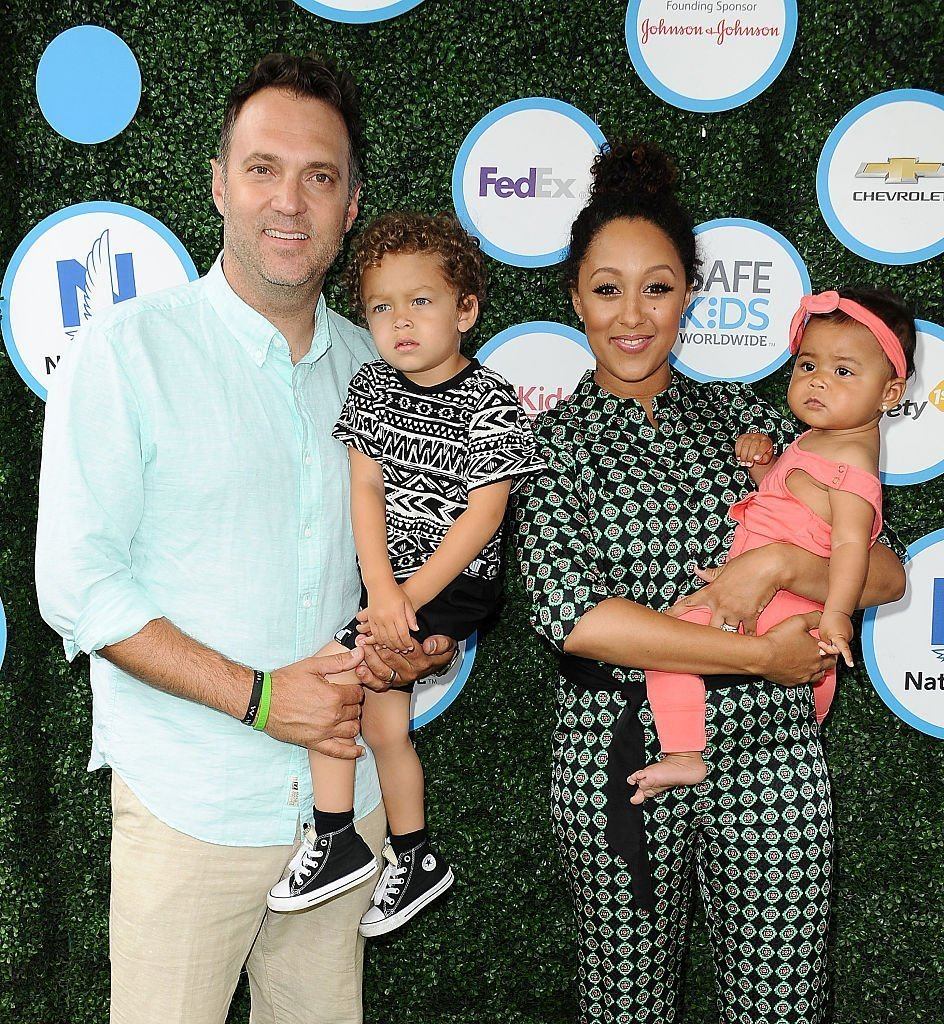 Adam Housley, Aden John Tanner Housley, Tamera Mowry and Ariah Talea Housley attend Safe Kids Day at Smashbox Studios in Culver City, California | Photo: Getty Images
