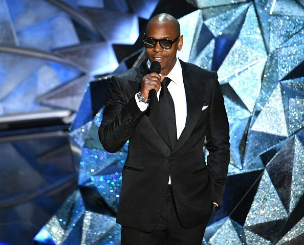 Comedian Dave Chappelle speaks onstage during the 90th Annual Academy Awards at the Dolby Theatre at Hollywood & Highland Center | Photo: Getty Images