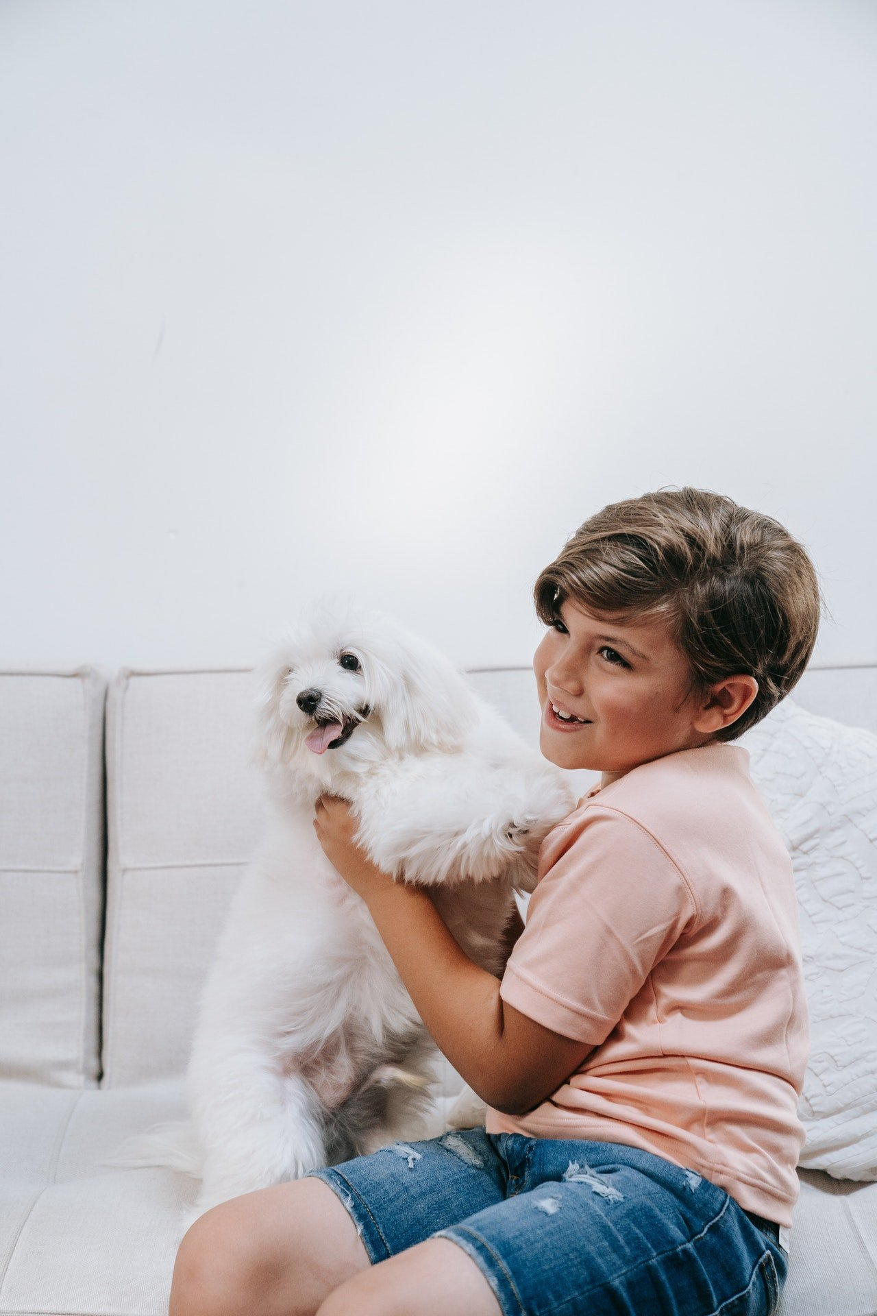 Boy sitting with a dog | Source: Pexels