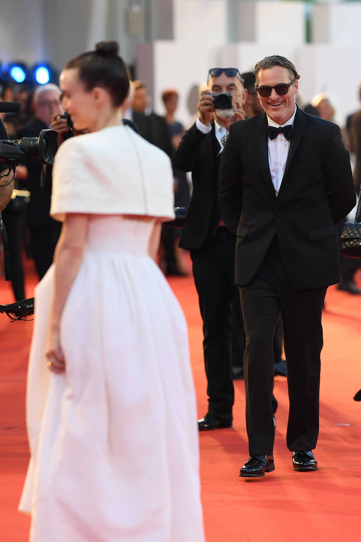 "Rooney Mara and Joaquin Phoenix walk the red carpet ahead of the ""Joker"" screening during the 76th Venice Film Festival at Sala Grande on August 31, 2019 in Venice, Italy. 