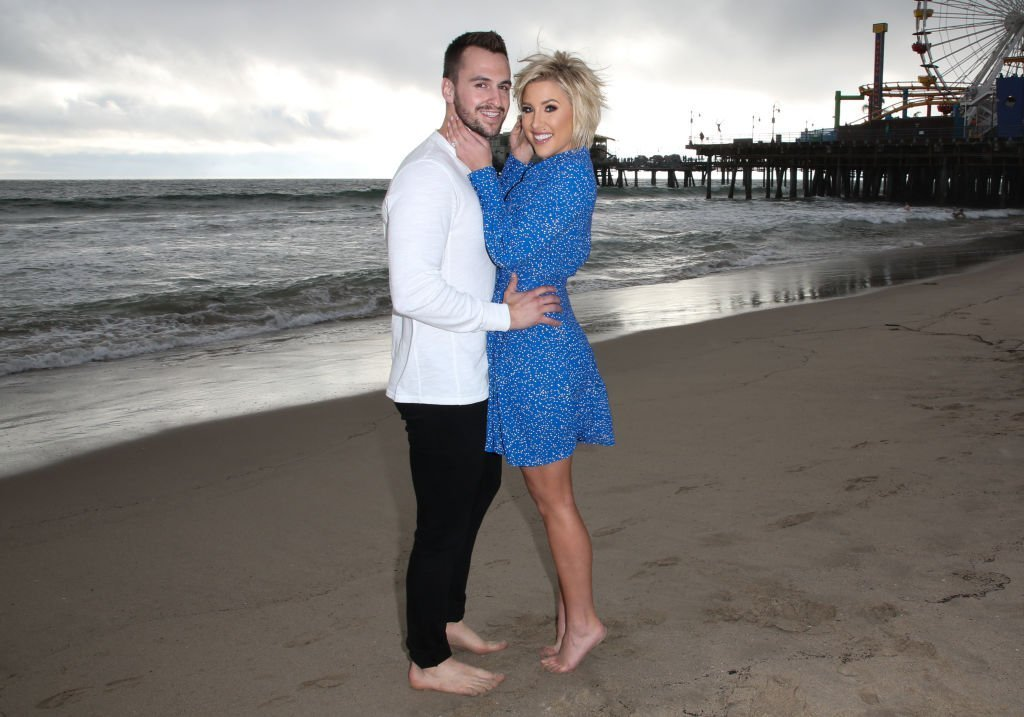 Savannah Chrisley and fiance Nic Kerdiles on the beach as they celebrate their Engagement from December 2018 | Photo: Getty Images