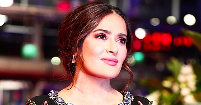 Salma Hayek Poses in a Red Swimsuit Showing off Tiny Waist, Massive Cleavage & Gorgeous Locks