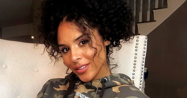 Brittany Bell Bares Her Growing Baby Bump as She Poses in a Stylish Off-Shoulder Top