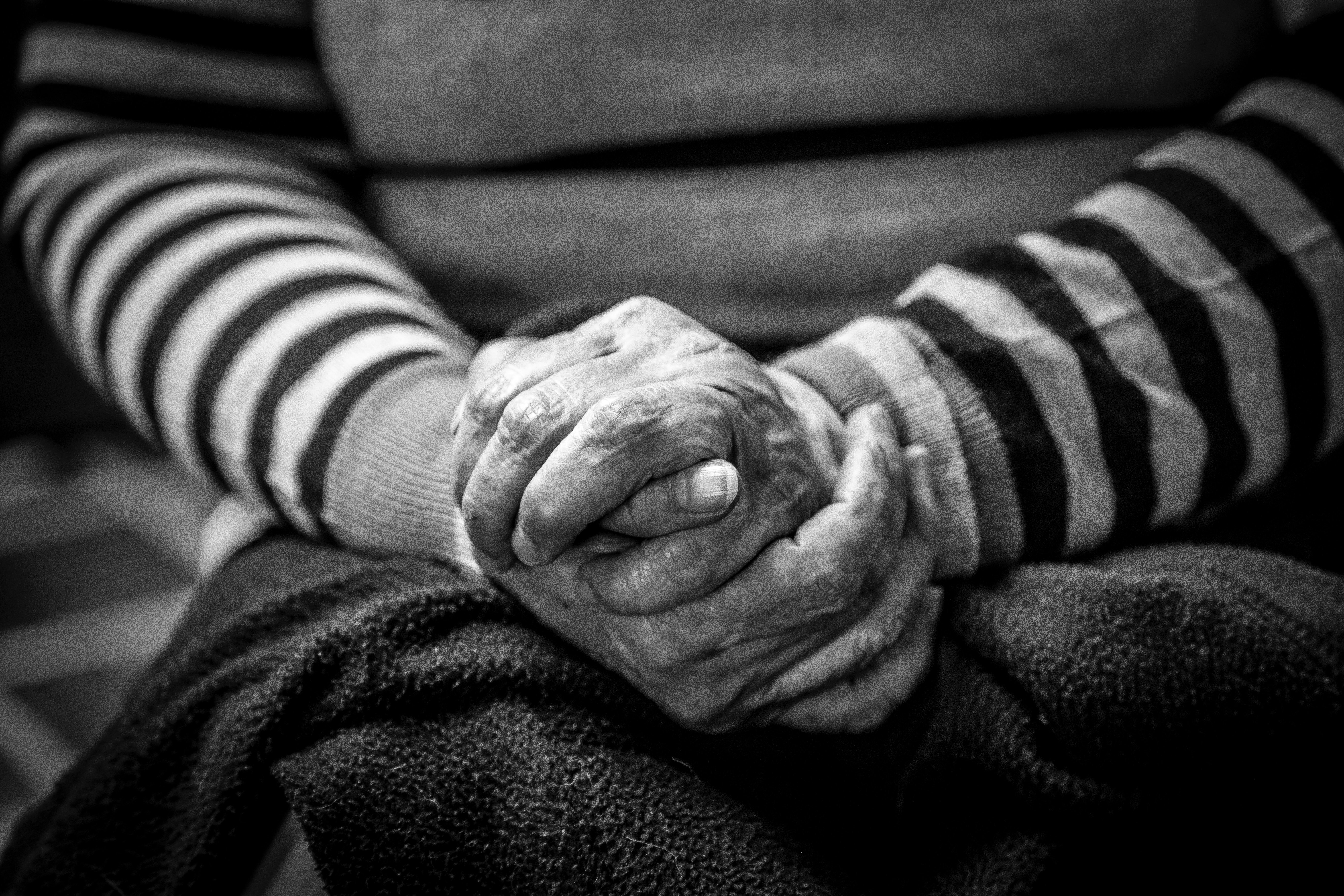 An old lady clasping her hands | Photo by Jorge Lopez on Unsplash