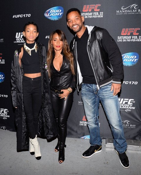 Willow Smith, actress/producer Jada Pinkett Smith and actor Will Smith attend the UFC 170 event at the Mandalay Bay Events Center on February 22, 2014, in Las Vegas, Nevada. | Source: Getty Images.