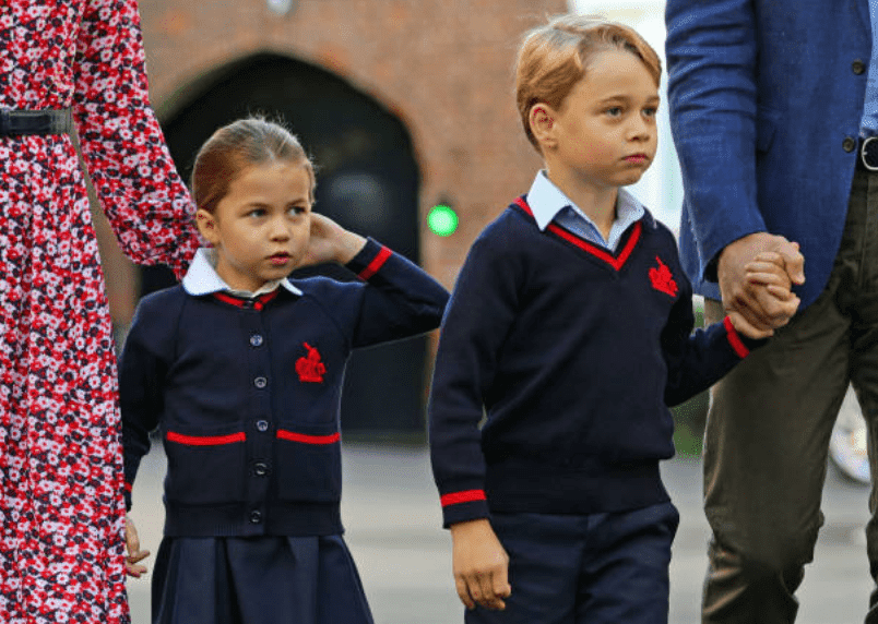 Princess Charlotte and her brother, Prince George arrive with their parents Kate Middleton and Prince William for their first day of school at Thomas's Battersea, on September 5, 2019, in London, England | Source: AARON CHOWN/AFP via Getty Images