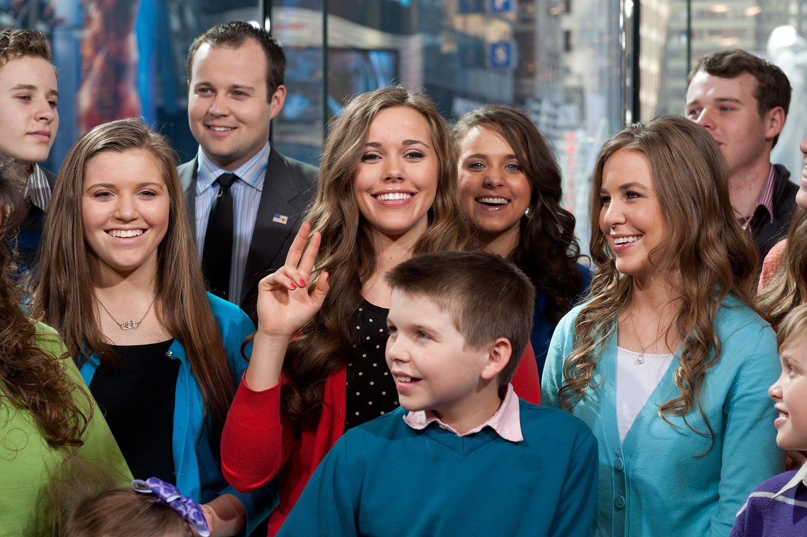 """The Duggar family at """"Extra"""" at their New York studios at H&M in Times Square on March 11, 2014 