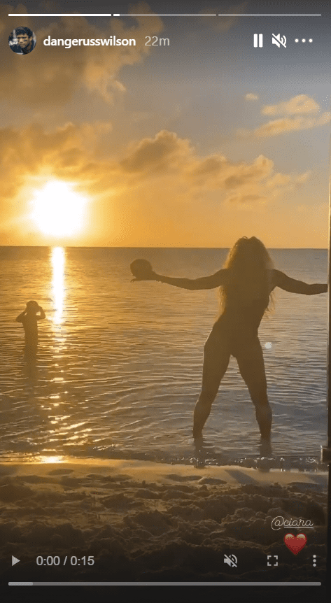 Ciara seen holding a football and dancing while on the beach | Photo: Instagram/dangerusswilson