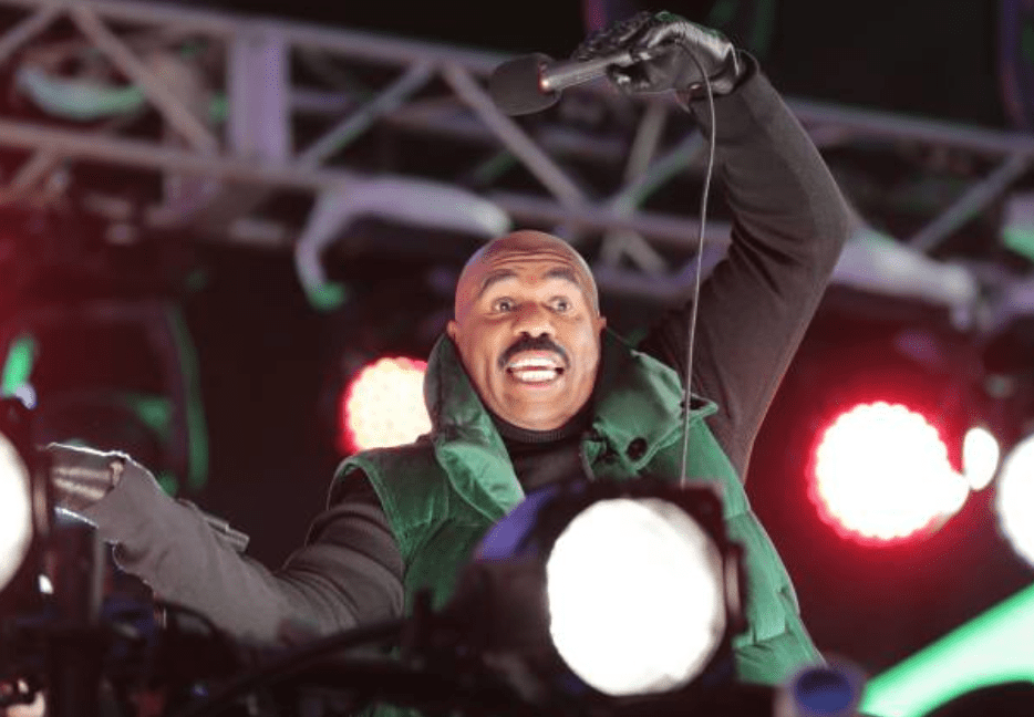 Steve Harvey holds a mic on stage at the Times Square on New Year's Eve on December 31, 2019, New York | Source: EuropaNewswire/Gado/Getty Images