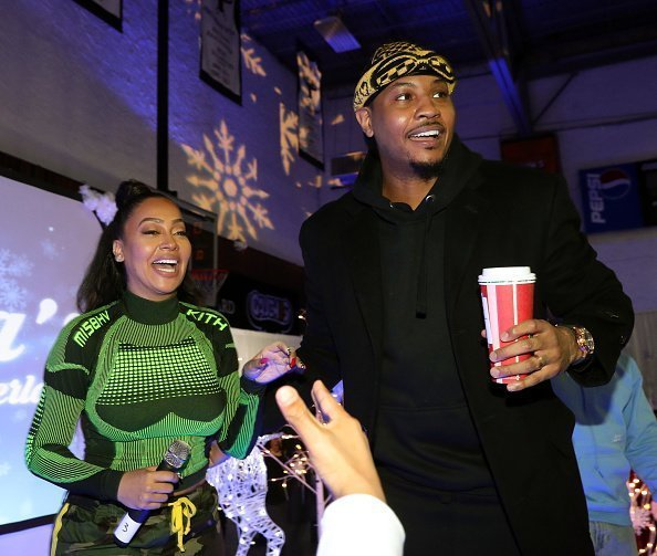 La La Anthony and Carmelo Anthony attend the 3rd Annual Winter Wonderland Holiday Charity Event Hosted By La La Anthony on December 17, 2018 | Photo: Getty Images