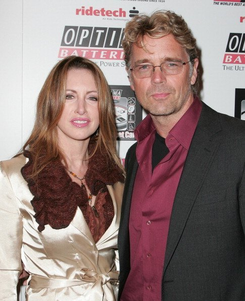 John Schneider and ex-wife Elly Castle at the OPTIMA Ultimate Street Car Broadcast premiere in Hollywood, California.| Photo: Getty Images