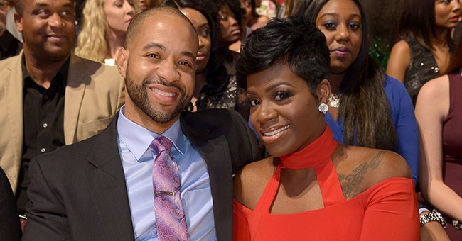 Fantasia Pours Killer Curves into Skintight White Dress Posing with Husband & Baby Daughter in Matching Gown