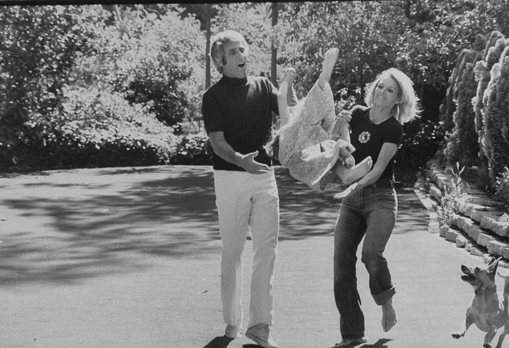 Composer Burt Bacharach Jr. (L) and his actress wife Angie Dickinson playing with their daughter, in Beverly Hills in 1974.   Source: Getty Images