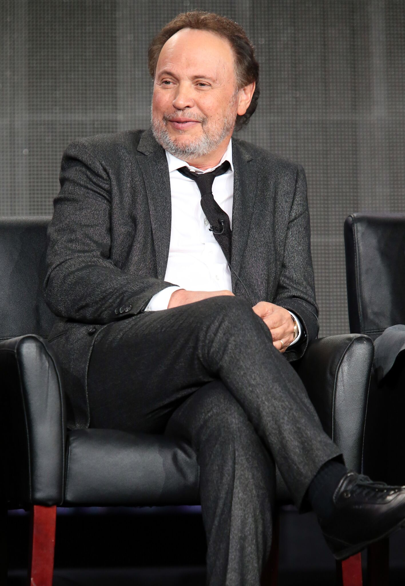 Executive producer/writer/actor Billy Crystal speaks onstage during the 'The Comedians' panel discussion at the FX Networks portion of the Television Critics Association press tour | Getty Images