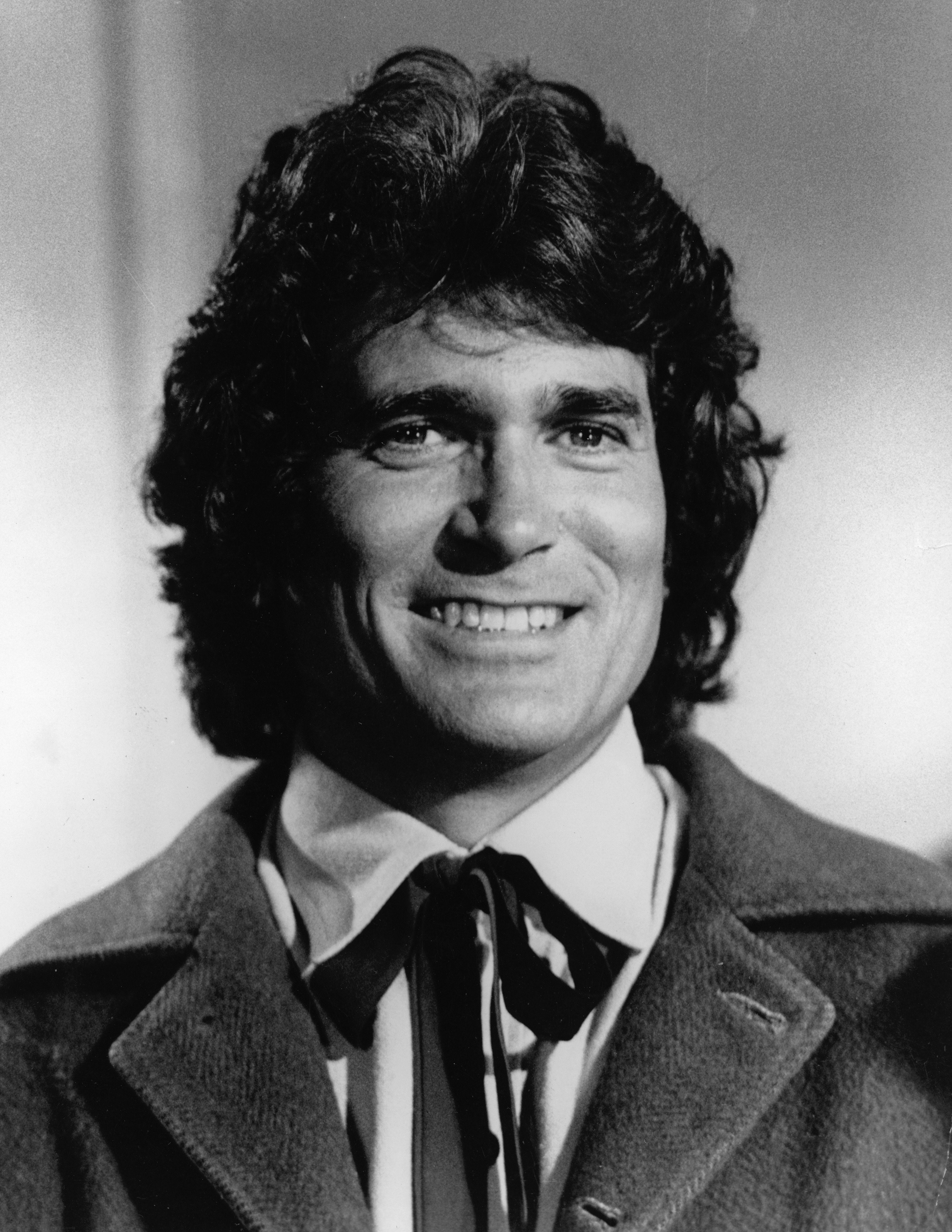"Headshot of American actor Michael Landon smiling in costume from the television series, ""The Little House On The Prairie."" 