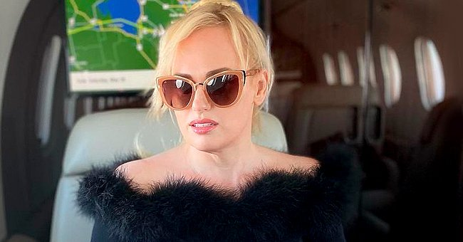 Rebel Wilson Looks Slimmer Than Ever in Black Top & Skintight Shorts While Taking a Private Jet