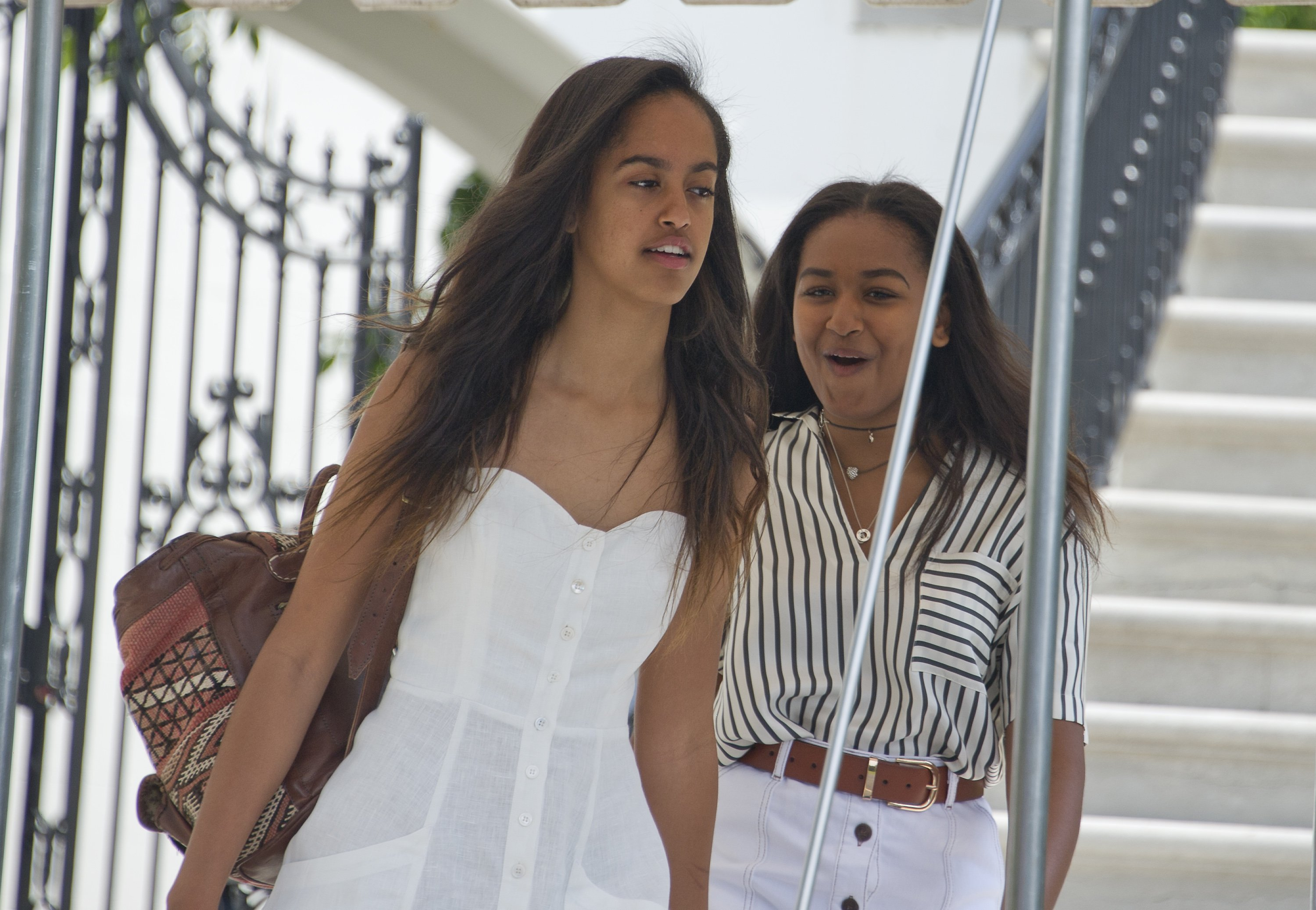 Malia and Sasha Obama depart the White House August 6, 2016   Photo: GettyImages