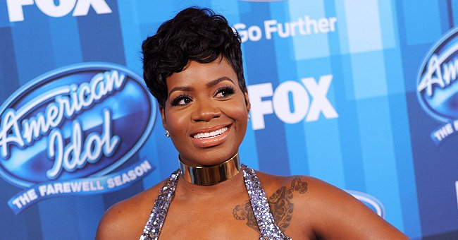 Fantasia's Daughter Zion Rocks Daring Tight Gown with Sheer Sleeves Wearing 2 Hair Puffs, Nose Piercing & Red Lips